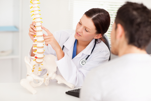 Consult with a back specialist, such as a chiropractor, about the non-invasive lower back treatment options available to you.
