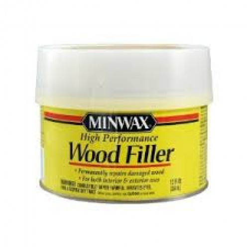 Wood putty is a good way to fill small holes in wood. They have putty that matches furniture colors.