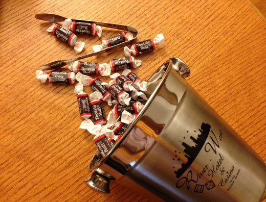 An imprinted mini ice bucket filled with candy can make an ideal New Year's business gift.