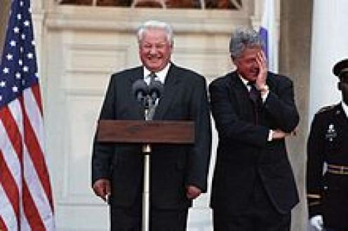 Yeltsin lets Clinton in on the joke.