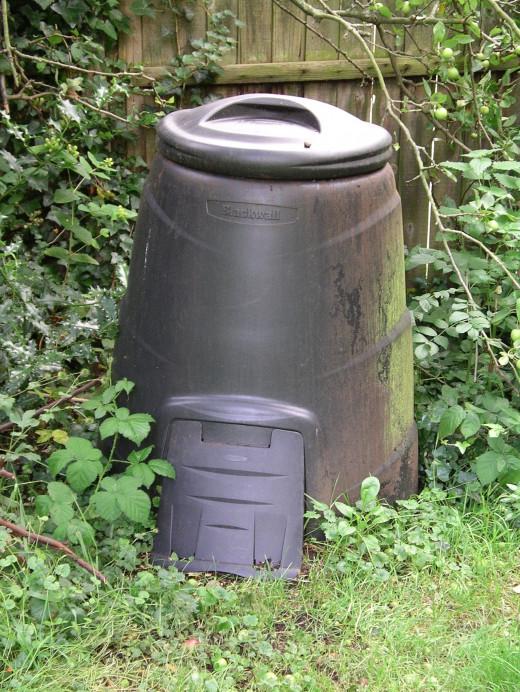 Black plastic compost bin.