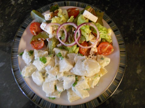 Herby potato salad served with a mixed greek-style salad makes a delicious light lunch or a substantial side dish