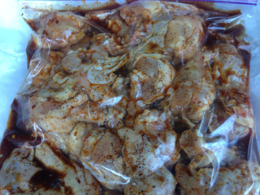 Wings and drumettes marinating in bag