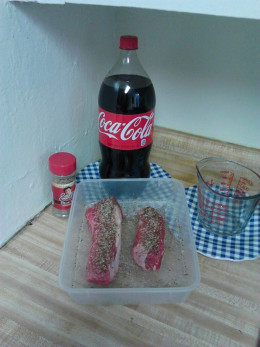 Steak, Coca Cola, Steak Rub.  I put my steak into my Tupperware Container and sprinkle with Steak Rub on Both Sides.