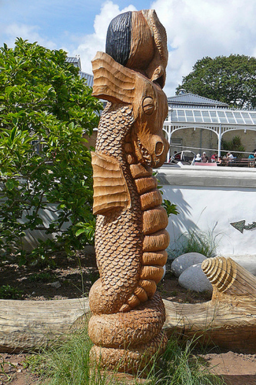 Things to Do In Falmouth: Find the Sea Monster Carving in Gyllyngdune Gardens.