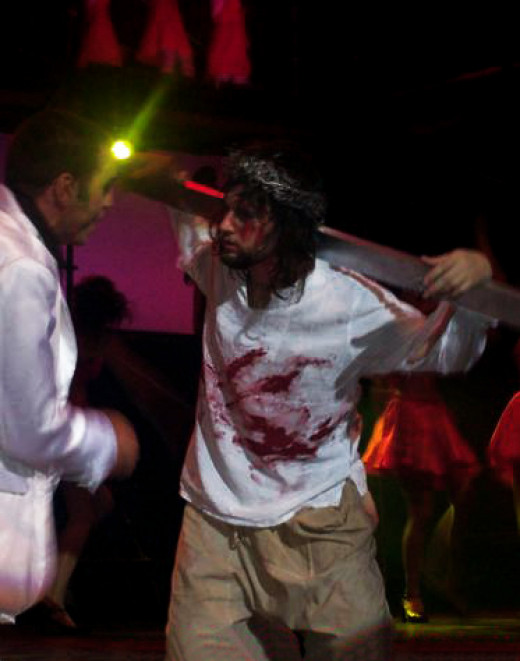 Jesus Christ, wearing a t-shirt, encounters the gospel-singing ghost of Judas Iscariot on the way to his crucifixion in 'Jesus Christ Superstar.'
