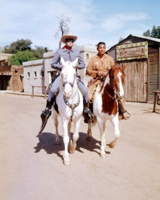 The Lone Ranger and Tonto riding Silver and Scout.