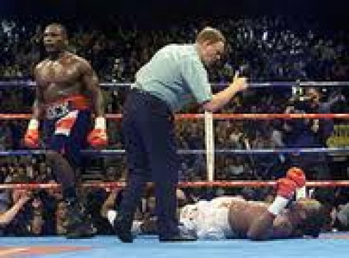 Hasim Rahman knocked out Lennox Lewis in 5 rounds in Africa to win the heavyweight crown.
