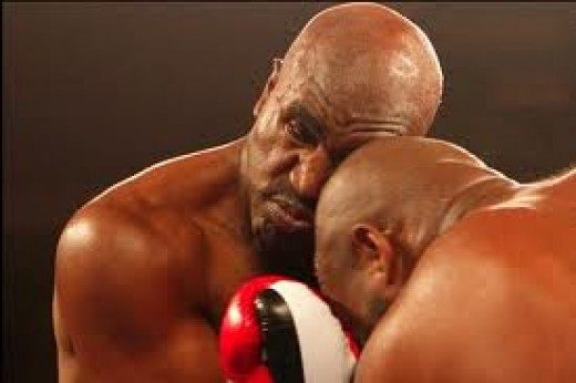 Evander Holyfield and his opponent accidentally clash heads.Head butts are fouls in boxing and they are illegal. If you head butt intentionally then you will be docked an instant point and / or disqualified.