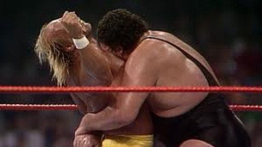 Andre the Giant has Hulk Hogan in a bear hug during a Wrestlemania bout. Andre has been Hulk's friend and his enemy during their primes.