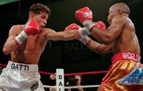 Arturo Gatti battles it out with Tracy Harris Patterson. Gatti beat Patterson by 12 round decision to win the Jr. Lightweight crown.