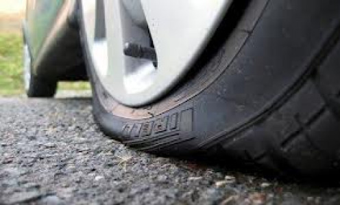 A flat tire can be fixed in numerous ways. Fix a Flat is very quick but it will not work with blow outs or very large punctures to the tire.