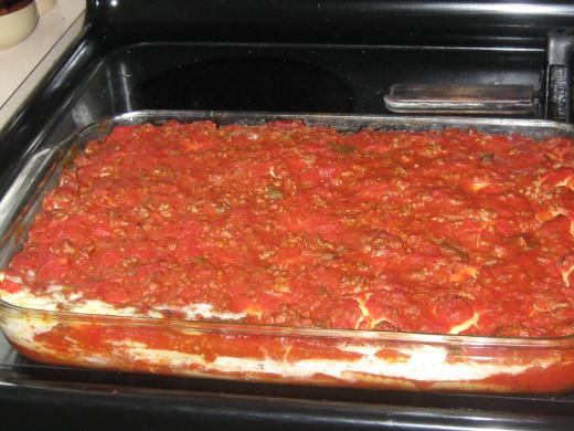 Layered Ravioli Lasagna ready for oven
