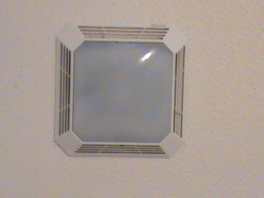 This ceiling light/ vent can be easily removed for easier painting