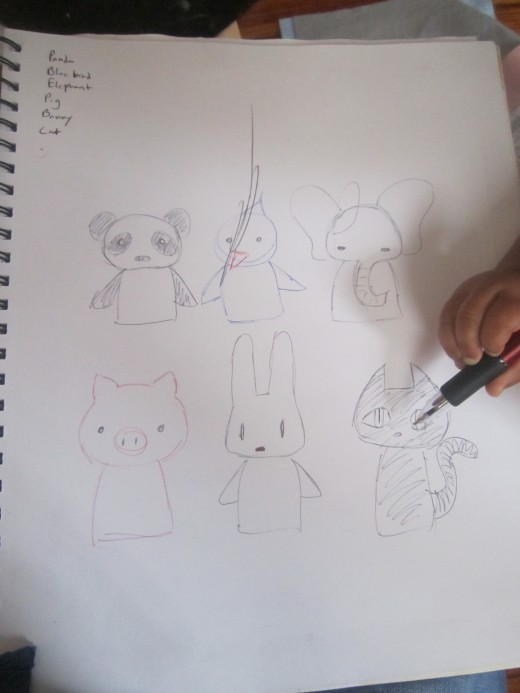 Here I sketched some animals I wanted to make finger puppets for (with Juju's help as you can see); a panda, a pig (Juju's favorite animal currently), an elephant, a bird, a bunny, and a cat.  Keep it as simple as you can!