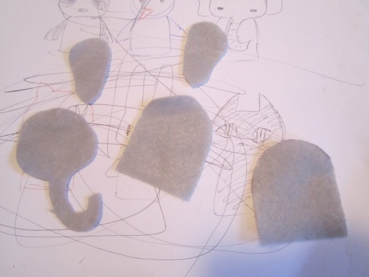 Cut out the shapes for your felt finger puppets.  Carefully cut along the lines so that you trim off the pen/pencil marks.
