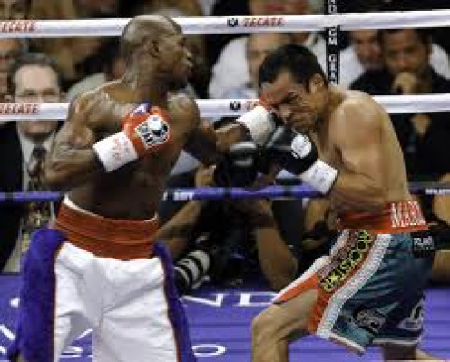 Floyd Mayweather knocked Juan Manuel Marquez down and scored a unanimous decision in their fight.
