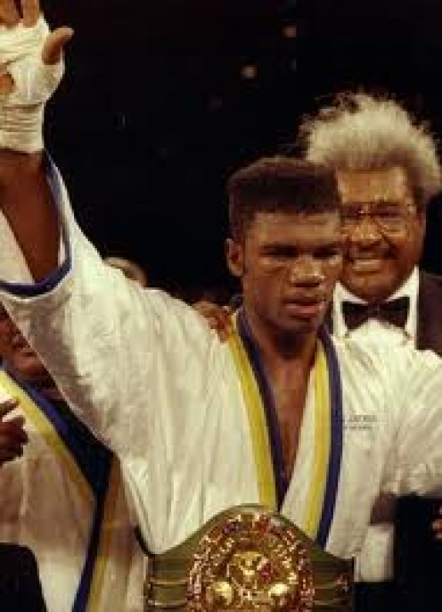 Julian Jackson, seen here with Don King, knocked out Terry Norris in two rounds with the Jr. Middleweight title on the line.