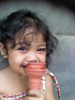 My little niece' smiles - taken by me! :=)