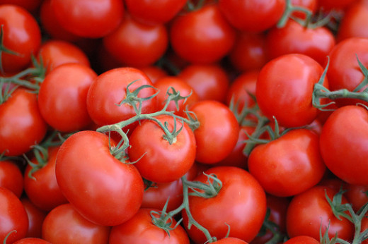Tomatoes, genetically engineered to last longer before spoilage can occur, and to have tougher skins for traveling more successfullu.