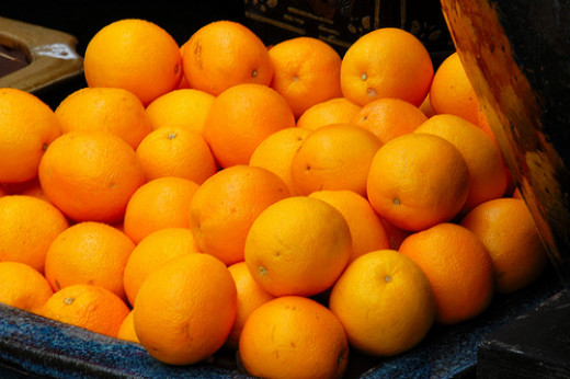 Oranges.  Some are genetically engineered to have thicker tougher skin to travel better.