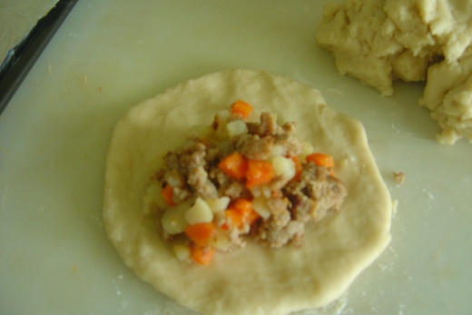 Step 4 - Making Meat Pie Pastry. Shape each part into a circular/oval shape. Then fill each with meat fillings.
