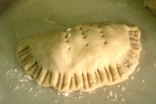 Step 6 - Making Meat Pie Pastry. Sealed pie, ready for glazing and the trip to the oven.