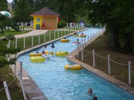 The lazy river goes around the whole water park and the water propels you and it is 4 feet deep.