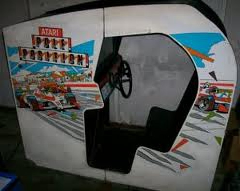 Pole Position was an arcade racing game that had a steering wheel, gear shifter, and gas and brake pedals.