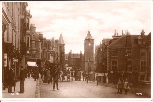 Old postcard picture of Crieff High Street, showing the Town Hall