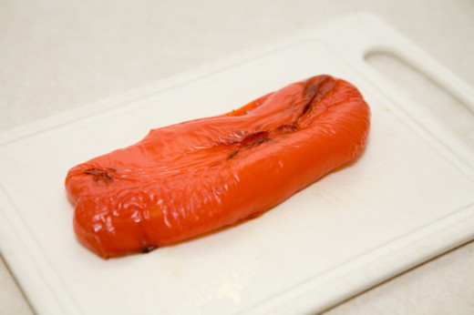 Take the roasted red pepper, remove the skin, and slice into 1/2-inch pieces.
