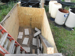 The Sump pit will have a sand bottom with patio blocks on the higher side of the floor and plain sand in the lower side of the floor . The floor is two different depths so we can place five gallon buckets under the clean outs and drain off the waste.