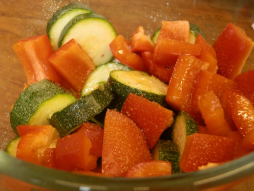 red pepper and courgette, chopped and salted