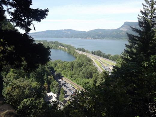 In the distance, the Columbia River Gorge forms a natural border between Washington on the right and Oregon on the left.