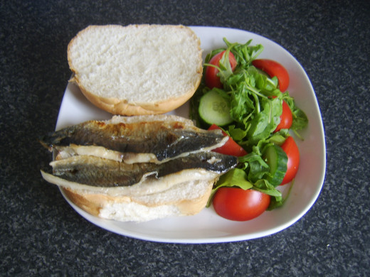Herring fillets are laid on bread roll