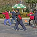 Elderly people at taichi in China, where it is a wide-spread practice.  Groups gather in parks everywhere and break into the various forms.