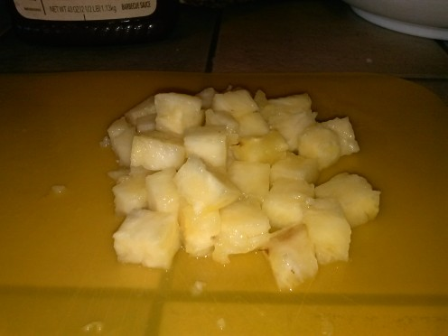 "Diced pineapple for this recipe should be about 1/4"" to 1/2"" on each side.  Honestly, this isn't an exact science.  Just cut it up so it cooks evenly.  Big pieces don't work well."