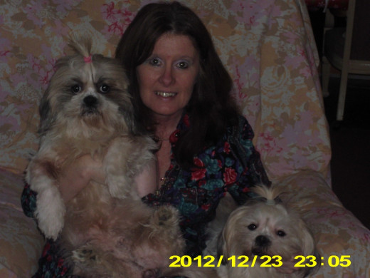 Me with my girls, Abby and Sunny. As you can tell these girls love for their pictures to be taken and love to be held.