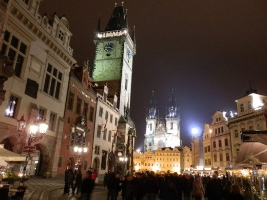 The fairytale-like Old Town Square in Prague with the Astronomical Clock Tower rising on the left