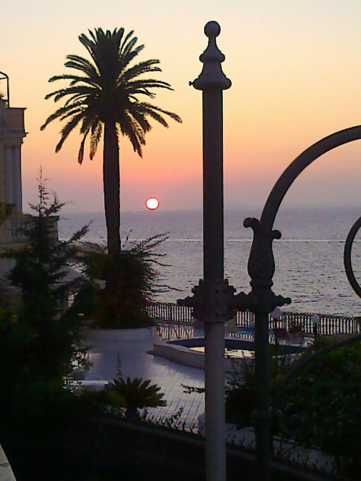Sun setting slowly into the Bay of Naples, seen from the balcony of The Foreigner's Club in Sorrento, Italy