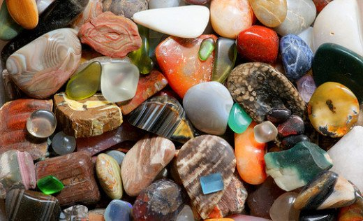A mix of polished gemstones suitable for crystal healing.