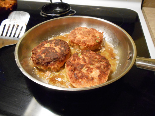 Tofu veggie burgers dredged in white whole wheat flour fry to a beautiful golden brown.