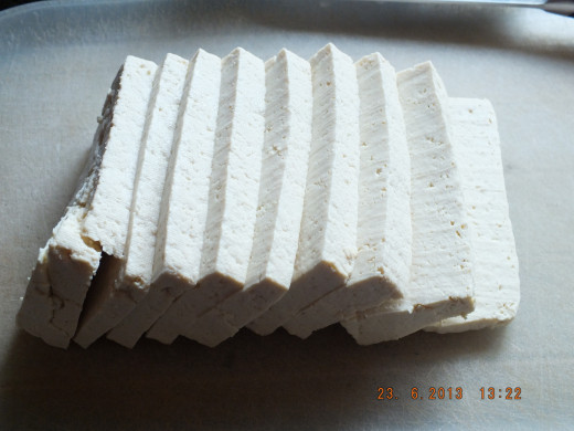 Slice your tofu 1/2 inch to 3/4 of an inch in thickness.