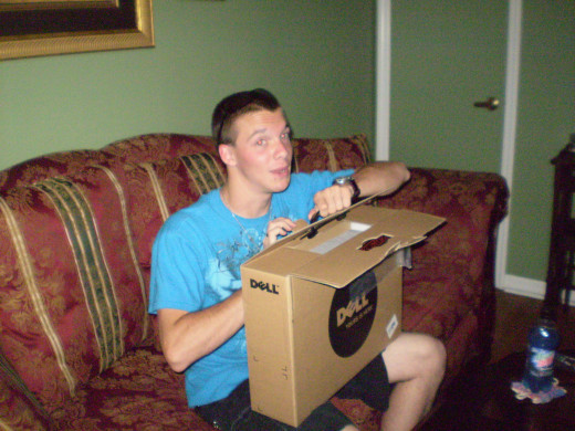 My son opening his high school graduation gift from me.