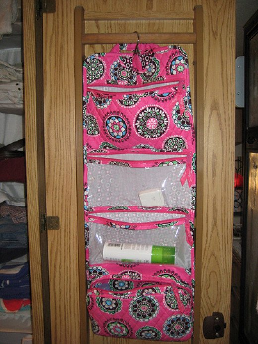 You can buy a hanging pocket organizer from any store for your FE! This is a Vera Bradley one -one proof that it doesn't have to be Disney themed!