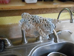 Hang wet dish towels on the neck of your kitchen faucet to allow them to dry between uses.