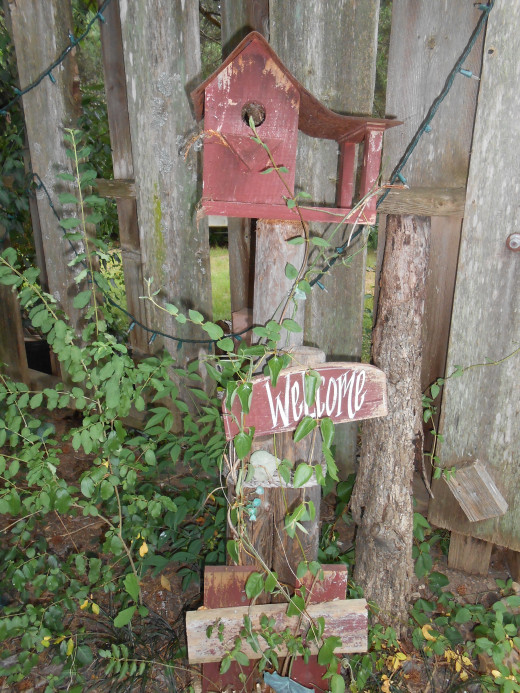 Welcome sign with bird house