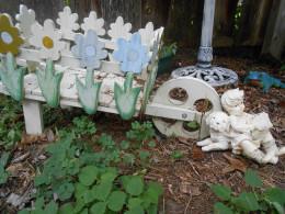 Decorative wheelbarrow with dog and boy statue