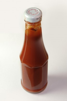 Catsup has about 1 teaspoon sugar (high fructose corn syrup) for every tablespoon.  Thats a ratio of 1:2