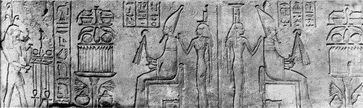 The seated figure is a Pharaoh, giant when compared to the other figures, but not a giant in real life.